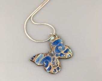 Bronze pendant, blue coloured butterfly