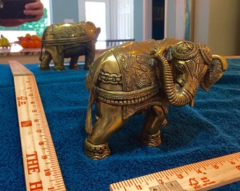 Highly detailed brass elephant figurine in full Buddhist attire