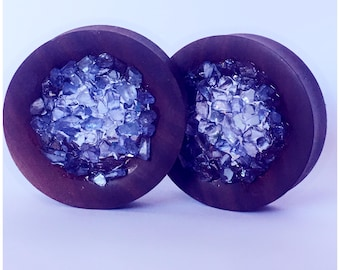 Wood and amethyst stone plugs, ear stretchers, ear guages, ear plugs.