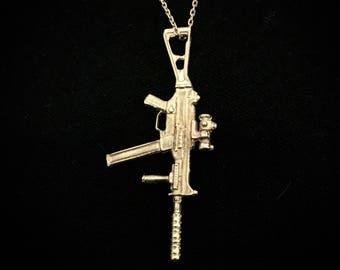 Solid silver sub machine gun pendant.