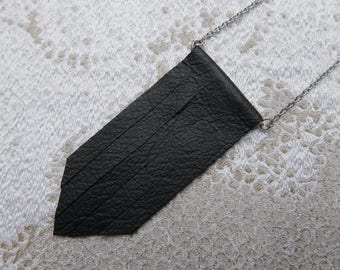 Pendant with black leather fringe