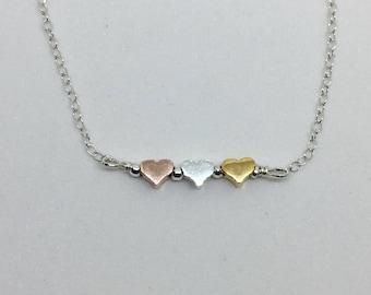 Tiny three tone heart bracelet