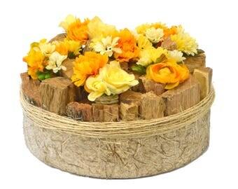 Silk flower arrangement Houtinrond