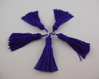 A purple color rayon thread tassel