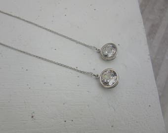 Silver Dangle Drop Earrings with a silver diamond at the end