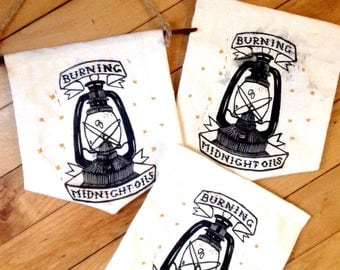 Burning Midnight Oils Logo | embriodery | relief print on muslin | banner