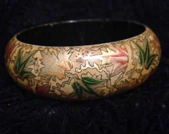 Vintage cuff bracelet with multi-colored design.