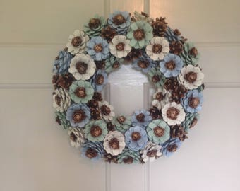 Handcrafted pinecone wreath. Suitable for indoor or outdoor decoration, wedding centre piece, funeral memorial, home decor. Custom made.