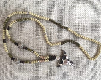 Gorgeous necklace in dark and light olive shades with silver Buffalo pendant