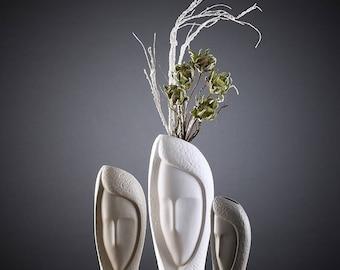 White ceramic decorative table top flower vase