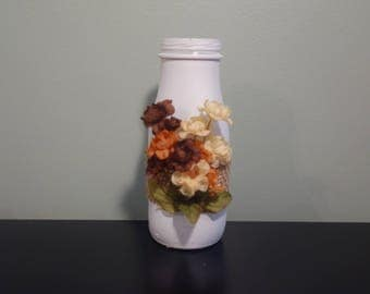 Upcycled white glass bottle with flowers, rustic