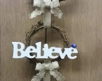 Believe triple wreath wall decor