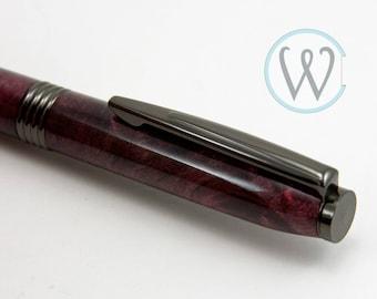 Trimline Twist Pen finished in Gun Metal Grey  with stabilized Red Buckeye Burl
