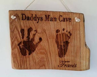 Handprints / Footprints engraved onto wood