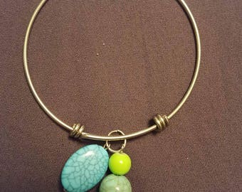Silver bangle with Green and Turquoise charms