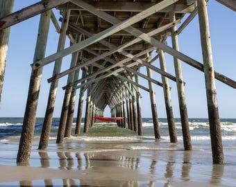 Photograph of pier with a hammock on Atlantic Ocean