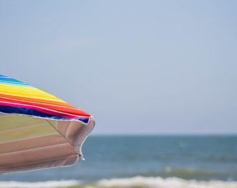 Photograph Beach and beach umbrella
