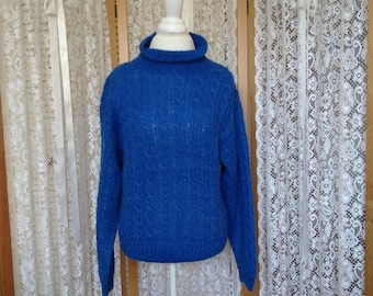 Very gently used, royal blue kid mohair, mock turtleneck, cable pullover. Size M.