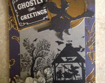 Halloween Card/Handmade Card/3D/a touch of Floral/Features a Witch Flying over a Very Creepy House/Has a Greeting and a Touch of Floral