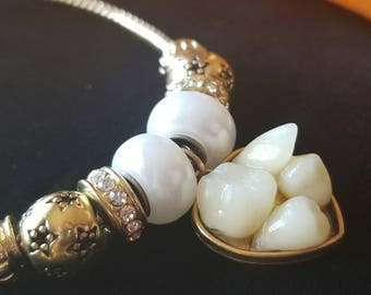 Tooth fairy charm bracelet, oddities and curiosities