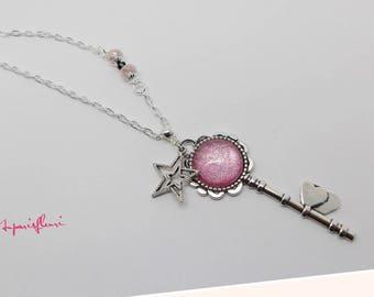 Starry pink glittery key necklace