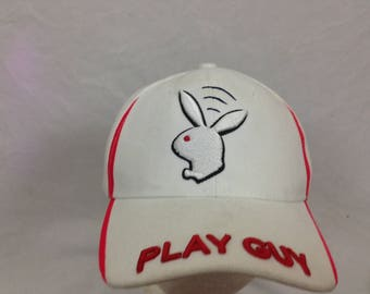 White n red play guy hat