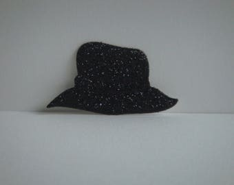 Cut little hat man in black glitter cardstock for creation