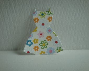 Cut paper flowers for creating design dress