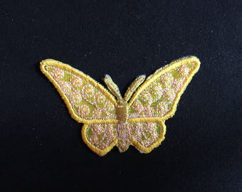 Applied fusible Yellow Butterfly and yellow in the middle and gold embroidered thread