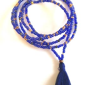 Necklace with seed beads in dark blue tassel.