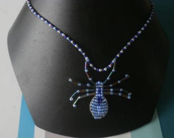 """Blue beaded """"Spider"""" necklace."""