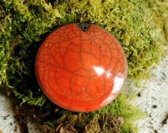 PENDANT for jewelry - round raku bead orange enamel.