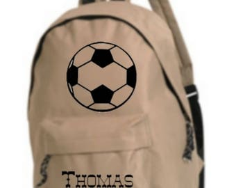 bag has beige football personalized with name