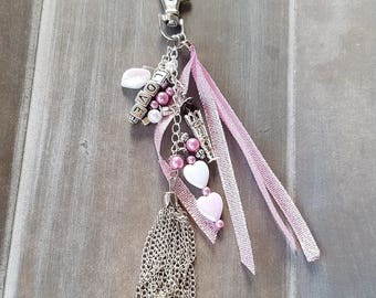 Metal pink handbag charm featuring a personalization option