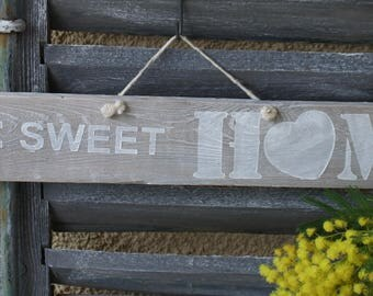 Home sweet home written on a wooden sign