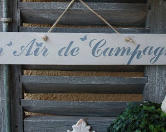 """A country look"" weathered wooden sign"