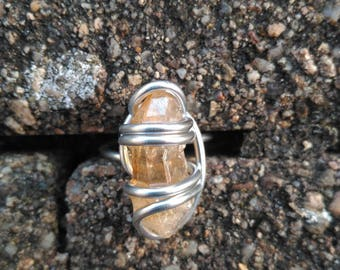 orange ring with a quartz point T 56