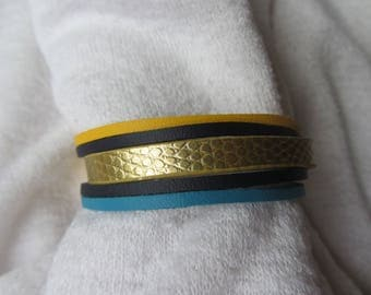 Cuff Bracelet gold, yellow, turquoise and Navy blue leather cords, gold metal toggle clasp