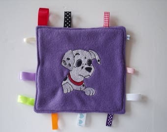 Purple plush fleece embroidered with a dog's head