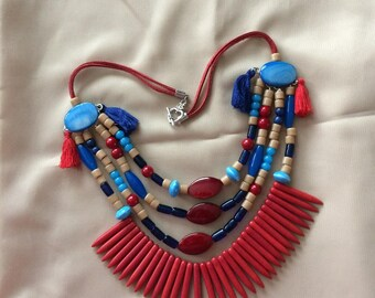 four color strand necklace red blue and cream