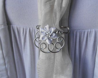 Brooch with white satin flower