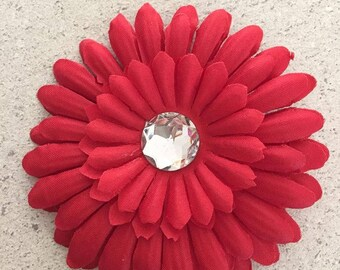 Barrette clip has red/Daisy with Rhinestone flower