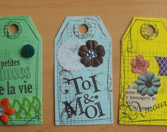 3 tags 1vert, 1 blue and 1 yellow for your scrapbooking creations.