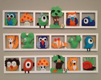 Frames and wall art to decorate the nursery and unique baby felt