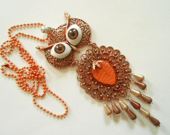1 OWL necklace with big brown eyes.