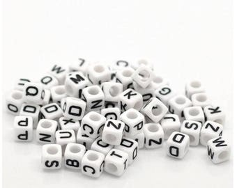 Set of 100 beads with letters