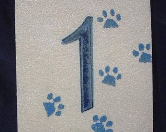 Number '1', original decorative ceramic door cat paws