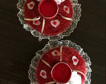 Red and white candle holders