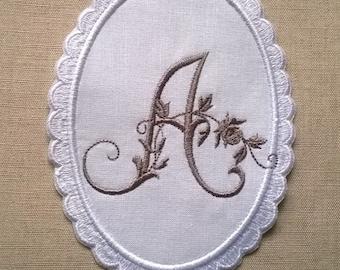 Monogram embroidered in a vintage Locket