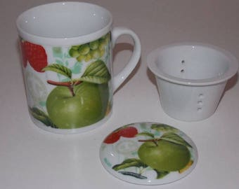 Apples on a porcelain mug